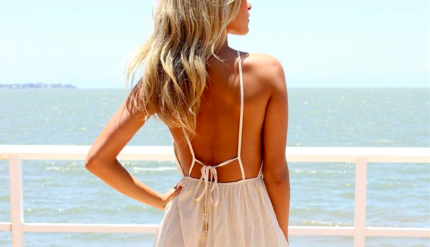 Female posing with a white dress and a smooth back