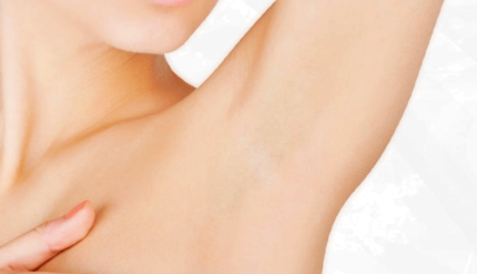 Waxing female underarm after being waxed