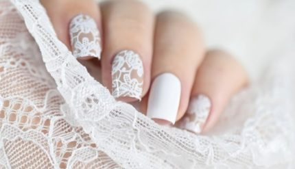 Hands with white floral nail art
