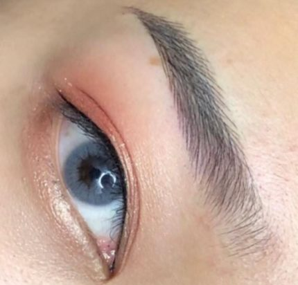 Female with blue eyes after effects of microblading