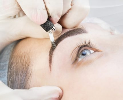 Eyebrow being microbladed