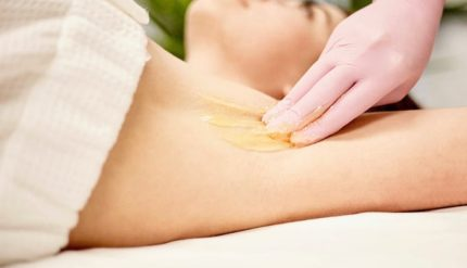 Sugaring hair removal on under arm